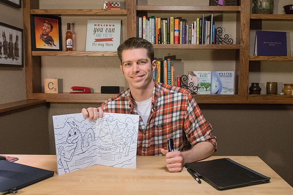 Casey Christenson illustrated this year's Kiwanis Holiday Lights coloring book that is given to children after they see Santa Claus. Christensen, a graduate of Minnesota State, said it took him about 2 weeks to make the illustrations in the book. Photo by Jackson Forderer