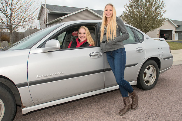 "Erin Olson (right), 16, has chosen to wait until she is 17 to get her driver's license. Until then, she has either been walking or getting a ride from her mom or her friend Ayva Brand (left). ""My parents wanted me to wait until I was 17 and I don't like driving because it's scary,"" said Olson. Photo by Jackson Forderer"