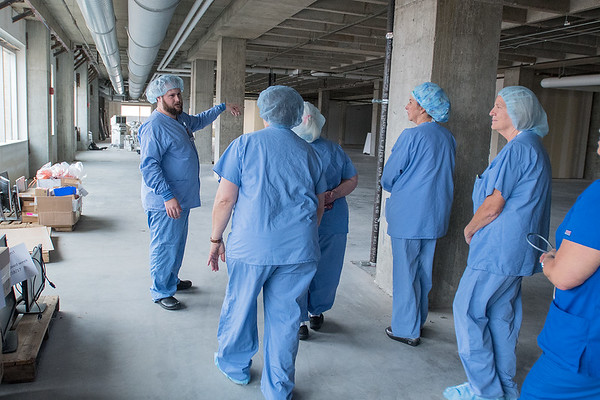 Dan Larson (left), nurse manager at Mayo Clinic Health System, gives a tour of the new operation room expansion area to other employees on Wednesday. Employees of Mayo were happy to see natural light from the windows in the expansion. Photo by Jackson Forderer