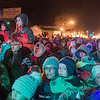 The bundled crowd listen to holiday songs played by a band featuring country music star Terri Clark during the Canadian Pacific Holiday Train's stop in Waseca on Tuesday. One train car opens into a stage for its various stops across the country. Photo by Jackson Forderer