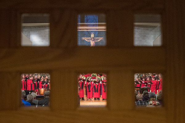 Members of the Bethany Lutheran concert choir are seen through the back door of the Trinity Chapel during a performance of Christmas at Bethany on Wednesday. Photo by Jackson Forderer