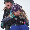 Laina Peterson, 8 plays with her sister Elleah Peterson, 5, in the snow at Bells on Belgrade. Even though the snow made some activities more difficult, many children come up with their own fun in the snow. Photo by Jackson Forderer