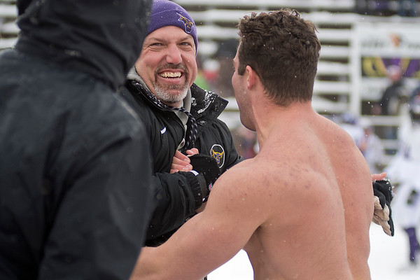 Minnesota State defensive coordinator Jim Glogowski  gets a laugh while being congratulated on the Mavericks win by a shirtless Chad Alft on Saturday. Photo by Jackson Forderer