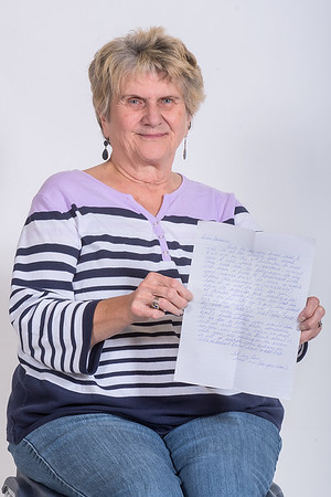 Lorraine Knutson holds up the most recent letter she received from her pen pal Merle Cantrell in Tasmania. Knutson recently met Cantrell, whom she started corresponding with 65 years ago. Photo by Jackson Forderer