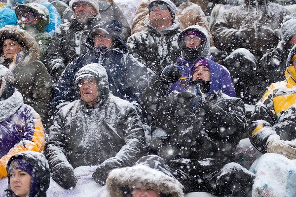 Minnesota State football fans cheer on the Mavericks as a whiteout snow blanketed the fans and the field. The Mavericks won the game in the tough conditions 13-10 to advance to the Division II semifinals. Photo by Jackson Forderer