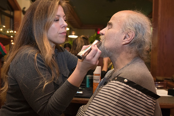 Joan Hurley shaves Bob Boelter Photo by Jackson Forderer