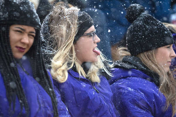 Kassandra McCarty catches snowflakes on her tongue while watching the Minnesota State football game against Tarleton on Saturday as a blizzard swept through the area. Photo by Jackson Forderer