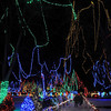 Visitors stroll under the canopy of the Kiwanis Holiday Lights display in Sibley Park.