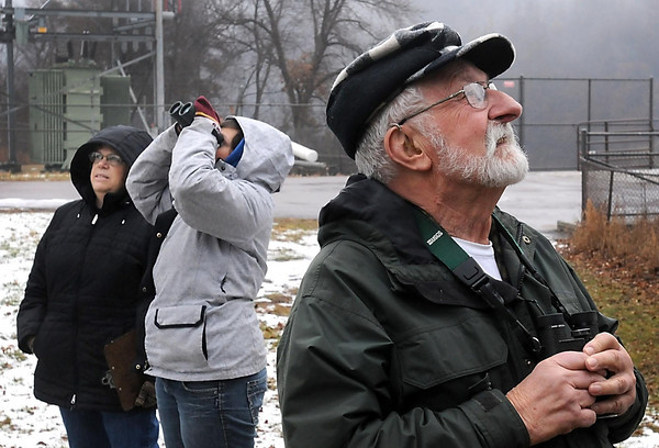 Linda Jenzen (left), her daughter Erynn and Merrill Frydendall look for birds in the trees surrounding the Rapidan Dam Park Saturday afternoon.