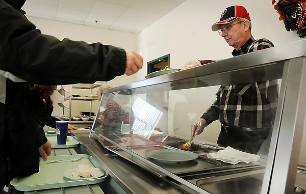 John Cross<br /> Salvation Army volunteer Joe Larson serves up hot lunches.