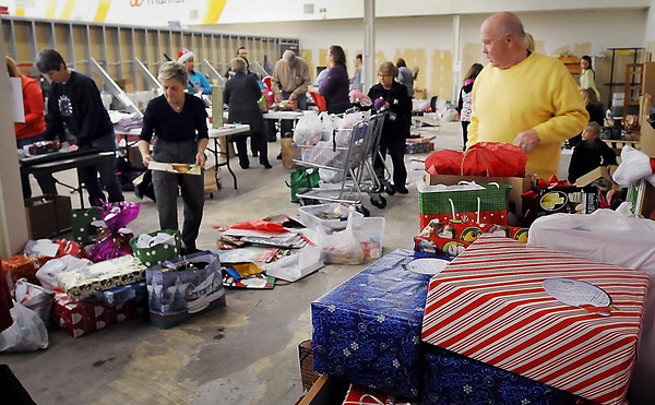 John Cross<br /> Volunteers wrap hundreds of gifts that will given to southern Minnesota Seniors in coming days. The gifts were donated through the Be a Santa to a Senior program coordinated by the Home Instead Senior Care home-health care agency.