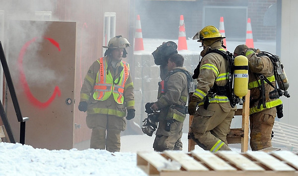Pat Christman<br /> Deputy Director of Public Safety Jeff Bengtson talks with firefighters before they enter the annex Saturday.