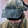 Pat Christman<br /> A firefighter's helmet is covered in soot during Saturday's practice burn.