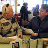 Pat Christman<br /> Blue Earth County Commissioner Drew Campbell is served papers by Blue Earth County Sheriff's deputy Don Gabler Thursday at the Wagon Wheel in Mankato.