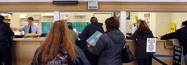 John Cross<br /> Customers que up to mail packages on Monday at the Mankato Post Office. The USPS said that the Monday prior to the week of Christmas traditionally is the busiest day of the holiday season for agency.