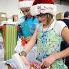 John Cross <br /> Girl Scouts Tayler Debill (left) and Abbie Bentson wrap giftson Tueday at the downtown Walgreens that were donated through the Be a Santa to a Senior program. <br /> The gifts will be distributed in coming days to southern Minnesota seniors who many not have family or friends in the area.