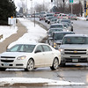 "Pat Christman<br /> Traffic on Adams Street stretches back to Highway 22 as holiday shoppers turn in to River Hills Mall Saturday. A new right turn lane planned next year will provide ""queuing capacity"" for scores of vehicles bringing holiday shoppers to the mall, along with improving traffic flow."