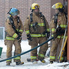 Pat Christman<br /> Firefighters enter the annex during Saturday's practice.
