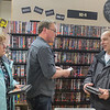 "Jim Gerber (right) and Shery Gerber (left) get help looking for movies from Tune Town owner Carl Nordmeier after the two brought a list into the store. Shery later said, ""We went up to St. Cloud and on the way back we stopped at every pawn and goodwill that we could see. We live two blocks from here and found everything we wanted right here."" Photo by Jackson Forderer"
