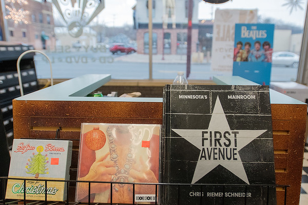 Tune Town owner Carl Nordmeier said that the book about First Avenue, Minneapolis' legendary music venue, has been a popular item this holiday season. Photo by Jackson Forderer