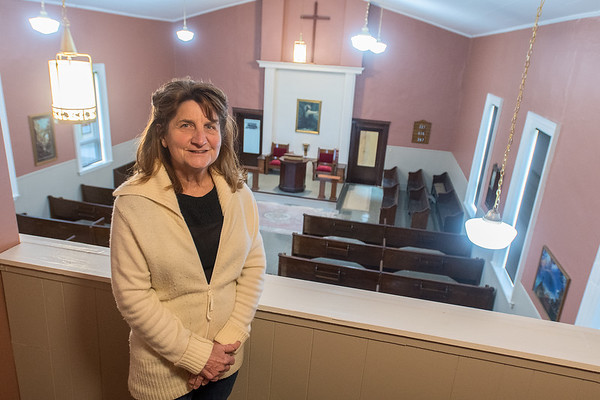 Roxie Mell-Brandts purchased the First Baptist Church in Garden City in November 2013 and has since renovated the building into an event space called Chapel of Peace. Part of the renovation was reopening the balcony, where Mell-Brandts is pictured here. Photo by Jackson Forderer