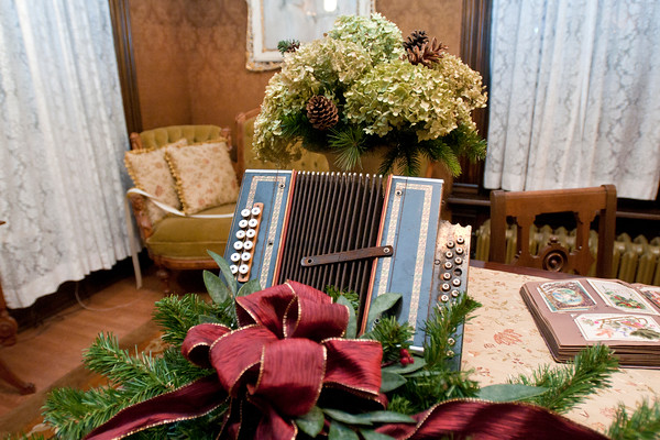 An accordion on display in the front room of the Hubbard House. This year, the house is filled with various musical instruments with participants invited to solve a mystery surrounding a missing violin. Photo by Jackson Forderer