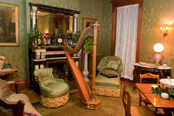 A harp in the living room at the Hubbard House will be just one of the many musical instruments that will be played or displayed during the Victorian Christmas this Saturday from 3-7 p.m. and Sunday from 1-4 p.m. People are invited to solve The Mystery of the Missing Violin this year. Photo by Jackson Forderer