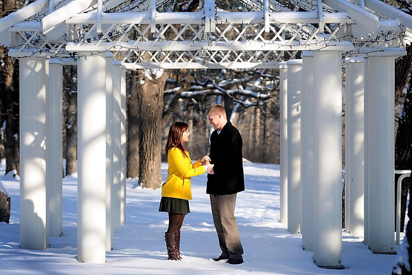 Josh Mayer proposed to Jonnica Norell in the pavilion overlooking the Kiwanis Holiday Lights at Sibley Park Thursday night.