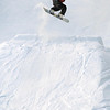 A snowboarder jumps off a ramp at Mount Kato's terrain park.