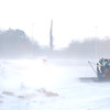 A snow plow clears drifts from along County Road 90 as the wind tries to rebuild them Thursday afternoon.