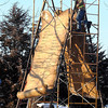 Workers assemble a new memorial Friday to the 38 Dakota Native Americans hanged in Mankato's Reconciliation Park. The memorial, designed to look like scrolls, lists the names of the 38 Dakota on one side and a poem by Mankatoan Katherine Hughes and a prayer by deceased Dakota elder Eli Taylor on the other. Pat Christman