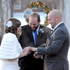 Bride Katlyn McKenzie puts a ring on groom Robert Grover's finger during their outdoor wedding ceremony Friday near Minnesota State University's Performing Arts Center. They chose the date to beat the purported Mayan Apocalypse.