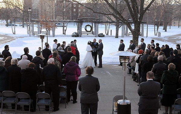 Katlyn McKenzie and Robert Grover exchange vows in 12-degree weather in front of MSU's Performing Arts Center Friday.