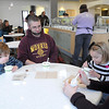 Chris and Stacy Lienemann and their children Owen, 3, and Zoe, 5, enjoy ice cream at the newly opened Mom & Pop's ice cream parlor in Mankato.