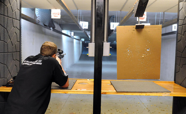 Ted Jacobson fires a .22-caliber rifle during a visit to the Vantage Point Shooting Range in Kasota.