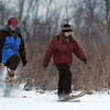 Pat Christman<br /> A couple snowshoe around the Good Counsel campus during a winter solstice celebration Saturday.