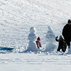 Pat Christman<br /> A family takes a break from sledding to build a pair of snowmen Friday at the Sibley Park sledding hill.