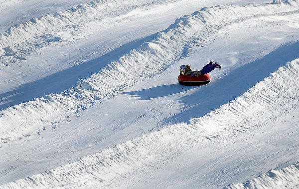 Pat Christman<br /> A tuber reaches top speed as she races down the hill at Mount Kato.