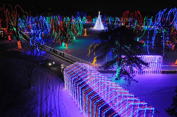 Pat Christman<br /> Cars travel through the lighted tunnel at the Kiwanis Holiday Lights as the rest of Sibley Park shines behind it last week. The park is lit up for 33 nights this Christmas season.