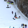 Pat Christman<br /> Sledders climb the Sibley Park sledding hill before taking another run.