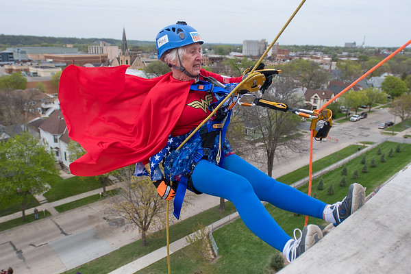 I was amazed to watch Margaret Gronstal, 88, not only attempting to rappel down the VINE building, but actually do it with ease. I was tethered to the building and as a breeze picked up Gronstal's cape I captured this moment at the start of her descent down the wall. Photo by Jackson Forderer