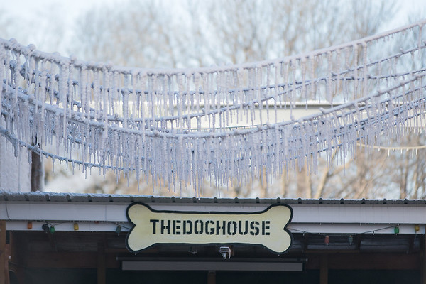 Icicles hang from power lines over the patio at the Dog House Bar & Grill after a fire was put out in downtown Janesville on Wednesday morning. Photo by Jackson Forderer