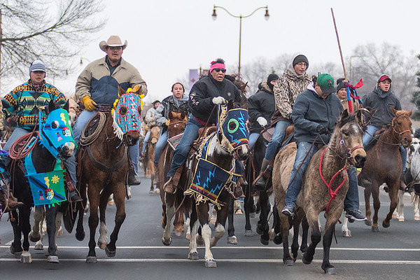 Dakota 38+2 Memorial Riders ride along Riverfront Drive as they neared Reconciliation Park at the end of their 17-day ride from South Dakota. Photo by Jackson Forderer