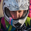 Lorelai Russell, 7, rides to the starting gate for a race at the BMX track on Wednesday. Lorelai competes in the 8 year old novice division. Her parents used small suction cups to attach the pigtails to her helmet. Photo by Jackson Forderer