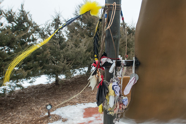 Mementos paying tribute to the Dakota 38 + 2 hang from the large memorial that lists the names of the 38 Dakota who were hanged on December 26, 1862. Photo by Jackson Forderer