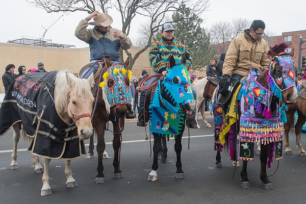 Dakota 38+2 Memorial riders sit atop their horses dressed in regalia along Riverfront Drive as the memorial ceremonies began in Reconciliation Park. Photo by Jackson Forderer