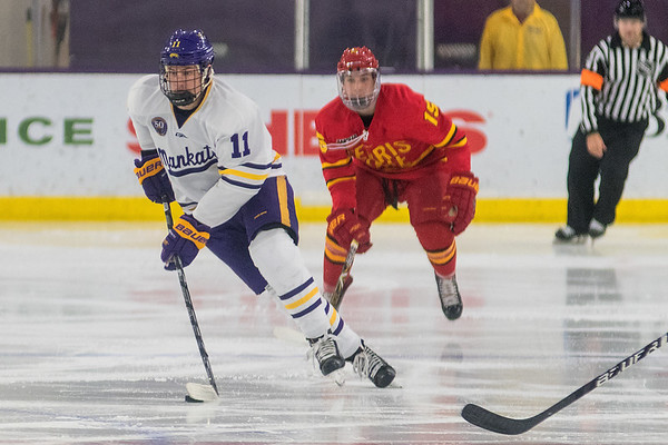 Minnesota State's Jared Spooner carries the puck up ice against Ferris State during Saturday's game played at the Verizon Center. Photo by Jackson Forderer