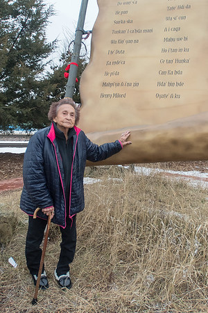 Betty Taylor, a 87 year-old Yankton Sioux from Wagner, S.D., said it was her first time visiting the Dakota 38+2 Memorial at Reconciliation Park. Taylor's great-grandfather, I te' Duta (fifth from bottom left), was one of the Dakota 38, although Taylor said she and her relatives knew him by a slightly different name. Photo by Jackson Forderer