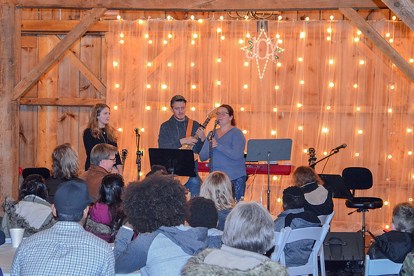 JR's Barn co-owner Renae Groskreutz, right, introduces a musical act that includes her son, Ben. Photo by Trey Mewes