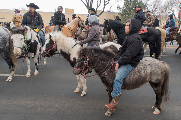 Jeremiah Shepherd (right), 12, waits with other Dakota 38+2 Memorial riders for the ceremonial events to begin at Reconciliation Park along Riverfront Drive. Photo by Jackson Forderer